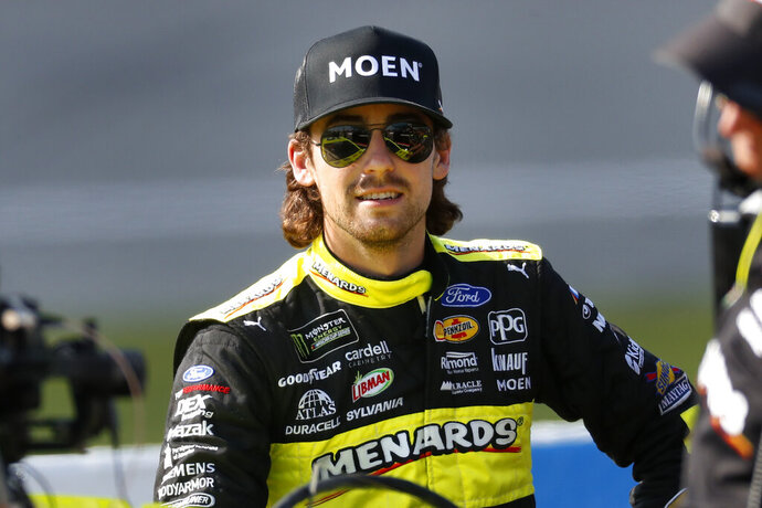 Ryan Blaney waits during qualifying for the NASCAR Cup Series auto race at Michigan International Speedway in Brooklyn, Mich., Friday, Aug. 9, 2019. (AP Photo/Paul Sancya)
