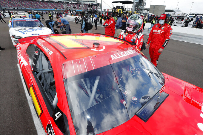 Justin Allgaier (7) climbs into his race car prior to the NASCAR Xfinity Series auto race at Phoenix Raceway, Saturday, Nov. 7, 2020, in Avondale, Ariz. (AP Photo/Ralph Freso)