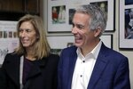 Republican presidential candidate former U.S. Rep. Joe Walsh, R-Ill., arrives with his wife Helene Walsh to file to have his name listed on the New Hampshire primary ballot, Thursday, Nov. 14, 2019, in Concord, N.H. (AP Photo/Charles Krupa)