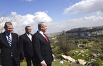 Israeli Prime Minister Benjamin Netanyahu, center, stands with Jerusalem Mayor Moshe Leon, second left, as he visits the area where a new neighborhood is to be built in the Israeli West Bank Israeli settlement of Har Homa, Thursday, Feb. 20, 2020. (Debbie Hill/Pool via AP)