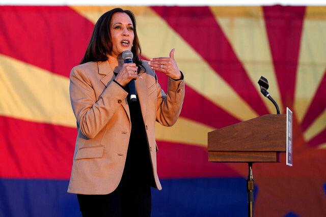 Democratic vice presidential candidate Sen. Kamala Harris, D-Calif., speaks at a mobile campaign event, Wednesday, Oct. 28, 2020, in Phoenix. (AP Photo/Matt York)