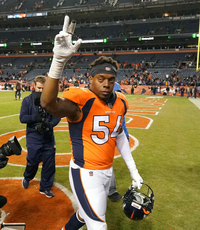 "FILE - In this Dec. 30, 2018, file photo, Denver Broncos inside linebacker Brandon Marshall gestures after an NFL game against the Los Angeles Chargers, in Denver. Even though Brandon Marshall was expecting it, Friday's, Feb. 15, 2019, news that he'd probably played his last game in Denver threw him for a bit of a loop. ""It's just different when it's in the news and everybody knows about it and it's not just you and your agent talking about it,"" Marshall said after the Broncos told his agent, Drew Rosenhause, they didn't plan to pick up Marshall's option. (AP Photo/Jack Dempsey, File)"