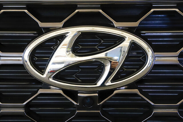 FILE - This Feb. 14, 2019 file photo shows the Hyundai logo on a 2019 Hyundai Santa Fe SUV on display at the 2019 Pittsburgh International Auto Show in Pittsburgh. Hyundai is recalling nearly 430,000 small cars because water can get into the antilock brake computer, cause an electrical short and possibly an engine fire. The latest recall covers certain 2006 through 2011 Elantra and 2007 through 2011 Elantra Touring vehicles. (AP Photo/Gene J. Puskar, File)