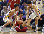 LSU guard Tremont Waters (3) and guard Skylar Mays (4) converge on Arkansas guard Jalen Harris, center, as the three go after a loose ball during the first half of an NCAA college basketball game Saturday, Feb. 2, 2019, in Baton Rouge, La. (AP Photo/Bill Feig)