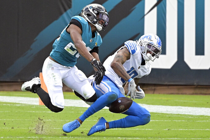 Jacksonville Jaguars cornerback CJ Henderson, left, breaks up a pass intended for Detroit Lions wide receiver Kenny Golladay during the second half of an NFL football game, Sunday, Oct. 18, 2020, in Jacksonville, Fla. (AP Photo/Phelan M. Ebenhack)