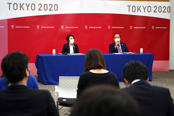 Seiko Hashimoto, left, president of the Tokyo 2020 Organizing Committee of the Olympic and Paralympic Games (Tokyo 2020), and Toshiro Muto, CEO of Tokyo 2020, attend a news conference Thursday, March 11, 2021, following the International Olympic Committee (IOC) general meeting. (AP Photo/Eugene Hoshiko, Pool)