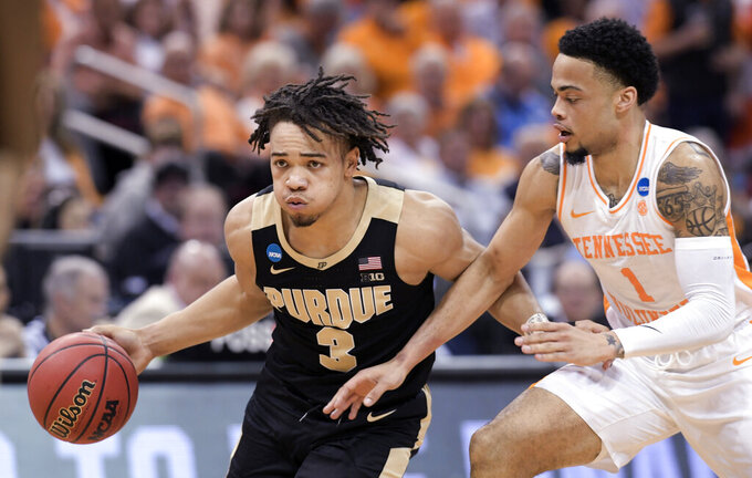 Purdue's Carsen Edwards (3) is defended by Tennessee's Lamonte Turner (1) during the second half of a men's NCAA Tournament college basketball South Regional semifinal game Thursday, March 28, 2019, in Louisville, Ky. (AP Photo/Timothy D. Easley)