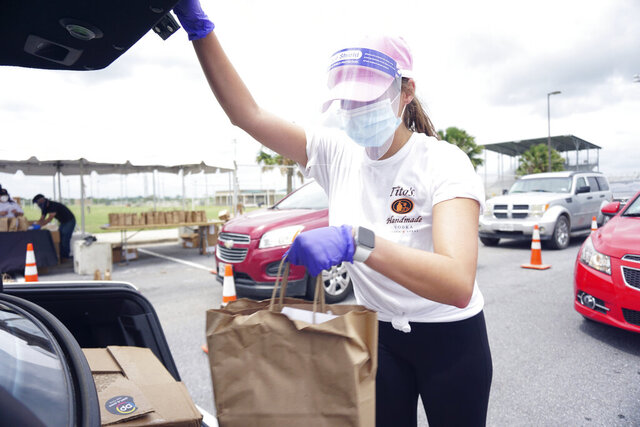 Austin, Texas made Tito's Handmade Vodka visits Brownsville, Texas Sports Park Saturday, Aug. 1, 2020, to distribute thousands of Tito's made hand cleanser sanitizer to thousands of Brownsville residents to help fight the spread of COVID-19. (Miguel Roberts/The Brownsville Herald via AP)