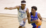 Boise State guard Devonaire Doutrive (11) makes a move inside as Memphis guard Landers Nolley II (3) defends during the first half of an NCAA college basketball game in the semifinals of the NIT, Thursday, March 25, 2021, in Denton, Texas. (AP Photo/Ron Jenkins)