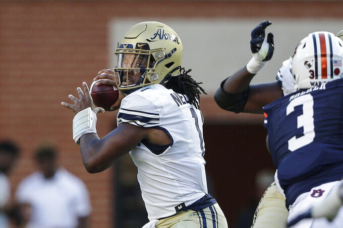 Akron quarterback Kato Nelson (1) looks for a receiver during the first half of the team's NCAA college football game against Auburn on Saturday, Sept. 4, 2021, in Auburn, Ala. (AP Photo/Butch Dill)