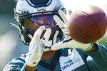 Philadelphia Eagles wide receiver DeVonta Smith catches the ball during practice at NFL football training camp, Thursday, Aug. 5, 2021, in Philadelphia. (AP Photo/Chris Szagola)