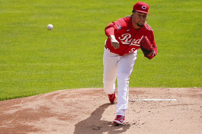 Cincinnati Reds' starting pitcher Luis Castillo (58) pitches in the first inning of a baseball game against the Pittsburgh Pirate at Great American Ball Park in Cincinnati, Wednesday, April 7, 2021. (AP Photo/Bryan Woolston)