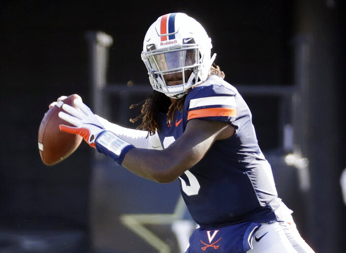 Virginia quarterback Bryce Perkins passes against Ohio in the first half of an NCAA college football game Saturday, Sept. 15, 2018, in Nashville, Tenn. (AP Photo/Mark Humphrey)