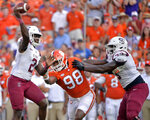 South Carolina State quarterback Corey Fields (2) passes the ball in the first half of an NCAA college football game against Clemson on Saturday, Sept. 11, 2021, in Clemson, S.C. (AP Photo/Edward M. Pio Roda)