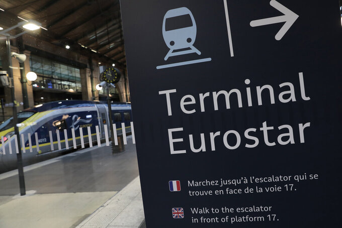 FILE - In this Dec.21, 2020 file photo, an information board is displayed at Gare du Nord train station in Paris. The chief of France's state rail the SNCF, which owns 55% of Eurostar, has sounded the alarm for the future of the train service that connects the UK with continental Europe. (AP Photo/Lewis Joly, File)