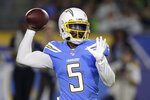 Los Angeles Chargers quarterback Tyrod Taylor passes against the Seattle Seahawks during the first half of an NFL preseason football game Saturday, Aug. 24, 2019, in Carson, Calif. (AP Photo/Gregory Bull)