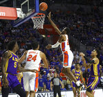 Florida guard Scottie Lewis (23) puts in a shot right around the rim during an NCAA college basketball game against LSU, Wednesday, Feb. 26, 2020 in Gainesville, Fla.  (Brad McClenny/The Gainesville Sun via AP)