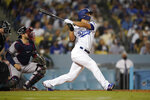 Los Angeles Dodgers' Corey Seager follows through on a two-run home run during the third inning of a baseball game against the Atlanta Braves, Monday, Aug. 30, 2021, in Los Angeles. (AP Photo/Marcio Jose Sanchez)