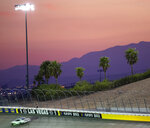 The sun sets behind the mountains as Chase Briscoe drives during the NASCAR Xfinity Series auto race at Las Vegas Motor Speedway on Saturday, Sept. 26, 2020, in Las Vegas. Briscoe won the race. (Ellen Schmidt/Las Vegas Review-Journal via AP)