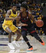 Stanford's Daejon Davis, right, drives the ball against California's Darius McNeill in the first half of an NCAA college basketball game Sunday, Feb. 3, 2019, in Berkeley, Calif. (AP Photo/Ben Margot)