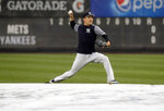 New York Yankees starting pitcher Masahiro Tanaka throws on the field after a baseball game against the New York Mets was postponed due to inclement weather, Monday, June 10, 2019, in New York. (AP Photo/Kathy Willens)