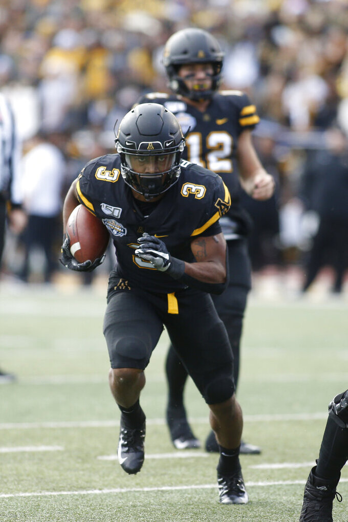 Appalachian State running back Darrynton Evans (3) takes the handoff from quarterback Zac Thomas (12) and runs for his second touchdown of the first half of an NCAA college football game in the Sun Belt Football Championship against Louisiana-Lafayette on Saturday, Dec. 7, 2019, in Boone, N.C. (AP Photo/Brian Blanco)