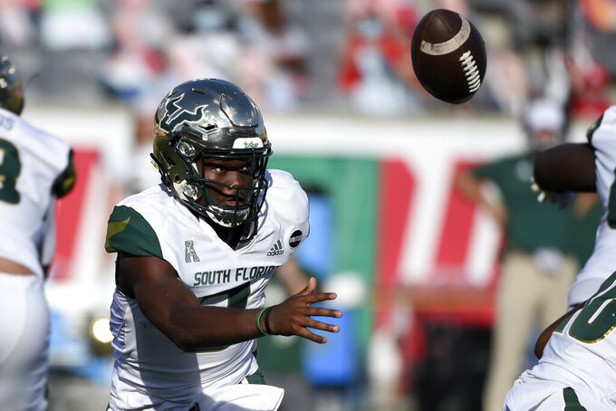 South Florida quarterback Jordan McCloud chases a high snap during the first half of an NCAA college football game against Houston, Saturday, Nov. 14, 2020, in Houston. (AP Photo/Eric Christian Smith)