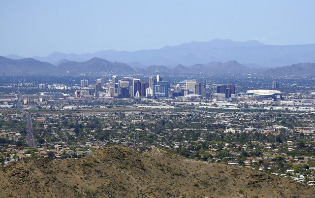 The downtown Phoenix skyline is easier to see, Tuesday, April 7, 2020, as fewer motorists in Arizona are driving, following the state stay-at-home order due to the coronavirus, and it appears to be improving the air quality and decreasing the effects vehicle emissions have on the environment. (AP Photo/Ross D. Franklin)