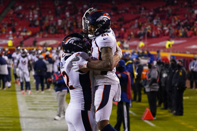 Denver Broncos wide receiver Tim Patrick (81) celebrates his five-yard touchdown reception with Austin Schlottmann (71) in the first half of an NFL football game against the Kansas City Chiefs in Kansas City, Mo., Sunday, Dec. 6, 2020. (AP Photo/Jeff Roberson)