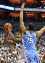 Louisville center Malik Williams (5) looks to shoot over the defensive pressure od North Carolina forward Garrison Brooks (15) during the second half of an NCAA college basketball game in Louisville, Ky., Saturday, Feb. 2, 2019. North Carolina won 79-69. (AP Photo/Timothy D. Easley)