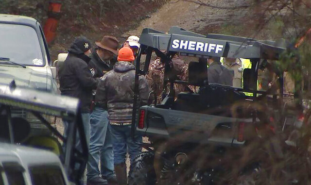In this photo provided by WSB-TV, authorities work the scene of a jet crash in a remote area in Gordon County, Ga., Saturday, Feb. 8, 2020. The wreckage of a small jet has been found in the area of Georgia, north of Atlanta. The Gordon County Sheriff's Office said Saturday that there were no signs of survivors. (WSB-TV via AP)