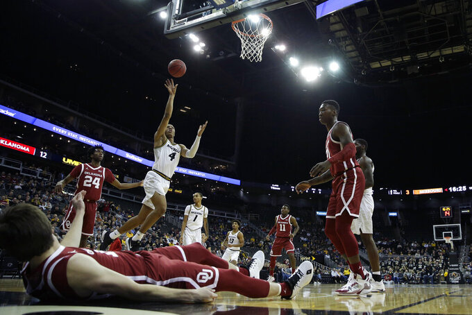 Missouri guard Javon Pickett (4) shoots during the first half of an NCAA college basketball game against Oklahoma, Tuesday, Nov. 26, 2019, in Kansas City, Mo. (AP Photo/Charlie Riedel)