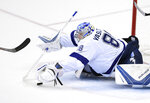 Tampa Bay Lightning goaltender Andrei Vasilevskiy, of Russia, reaches for the puck during the third period of Game 3 of the team's NHL Eastern Conference finals hockey playoff series against the Washington Capitals, Tuesday, May 15, 2018 in Washington. The Lightning won 4-2. (AP Photo/Nick Wass)