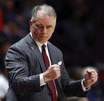 Virginia Tech head coach Mike Young celebrates a score against Clemson during the first half of an NCAA college basketball game Wednesday, March 4, 2020, in Blacksburg, Va. (Matt Gentry/The Roanoke Times via AP)