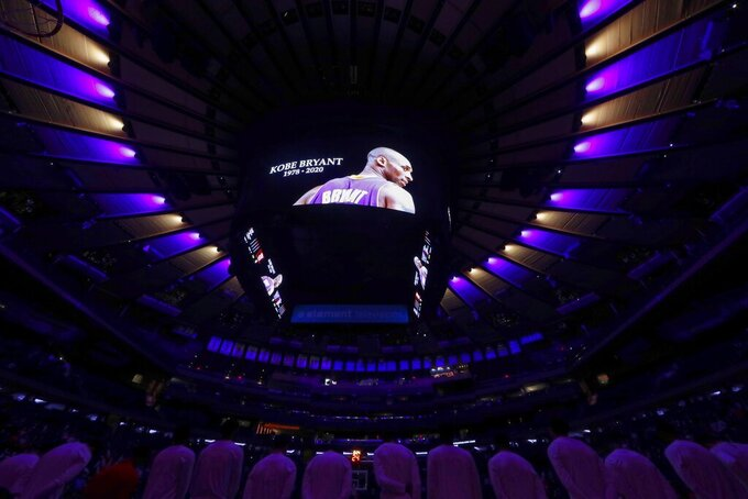 A photo of Kobe Bryant is shown during a tribute to him before an NCAA college basketball game between St. John's and Villanova Tuesday, Jan. 28, 2020, in New York. (AP Photo/Frank Franklin II)