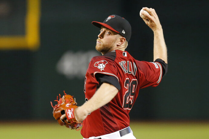Arizona Diamondbacks pitcher Merrill Kelly throws in the first inning during a baseball game against the New York Mets, Sunday, June 2, 2019, in Phoenix. (AP Photo/Rick Scuteri)