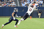 Chicago Bears wide receiver Rodney Adams (13) makes a catch as he is defended by Tennessee Titans cornerback Caleb Farley (3) in the first half of a preseason NFL football game Saturday, Aug. 28, 2021, in Nashville, Tenn. (AP Photo/Mark Zaleski)