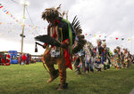Native American dancers perform at the annual Comanche Nation Fair Powwow, Sunday, Sept. 22, 2019, in Lawton, Okla., where Democratic presidential candidate U.S. Sen. Bernie Sanders addressed supporters. (AP Photo/Gerardo Bello)