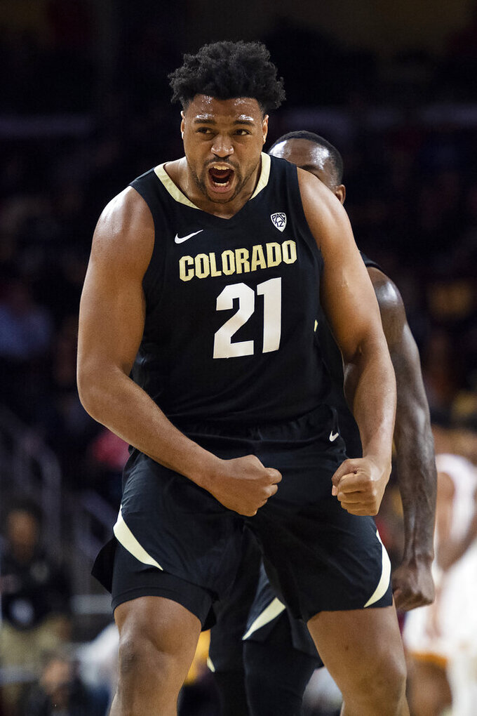 Colorado forward Evan Battey celebrates after scoring a basket during the first half of the team's NCAA college basketball game against Southern California on Saturday, Feb. 1, 2020 in Los Angeles. (AP Photo/Kyusung Gong)
