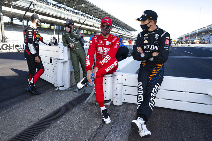 Oliver Askew, right, talks with Marcus Ericsson, of Sweden, before practice for the Indianapolis 500 auto race at Indianapolis Motor Speedway in Indianapolis, Friday, Aug. 21, 2020. The 104th running of the Indianapolis 500 auto race is scheduled to run on Sunday.(AP Photo/Michael Conroy)