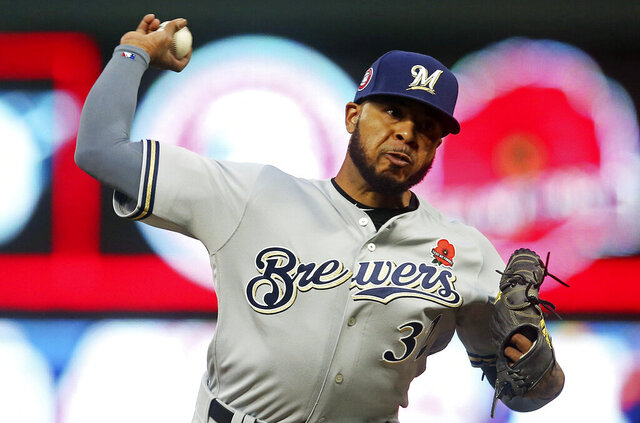 FILE -In this May 27, 2019 file photo Milwaukee Brewers relief pitcher Jeremy Jeffress throws against the Minnesota Twins in the fifth inning of a baseball game in Minneapolis. The Chicago Cubs and free-agent reliever Jeremy Jeffress have agreed to an $850,000, one-year contract. A person with direct knowledge of the situation confirmed the deal on Tuesday, Jan. 28, 2020 on condition of anonymity because the move had not been announced. (AP Photo/Jim Mone, File)