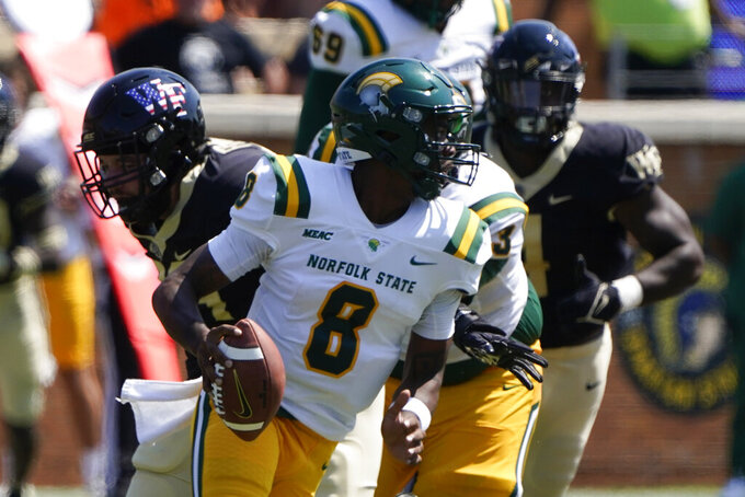 Norfolk State quarterback Juwan Carter looks to pass against the Wake Forest during the first half of a NCAA college football game Saturday, Sept. 11, 2021, in Winston-Salem, N.C. (AP Photo/Chris Carlson)