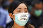 A pro-democracy protester marches in the city center ahead of reported plans by the city's embattled leader to deploy emergency powers to ban people from wearing masks in a bid to quash four months of anti-government demonstrations, Friday, Oct. 4, 2019, in Hong Kong. (AP Photo/Vincent Thian)