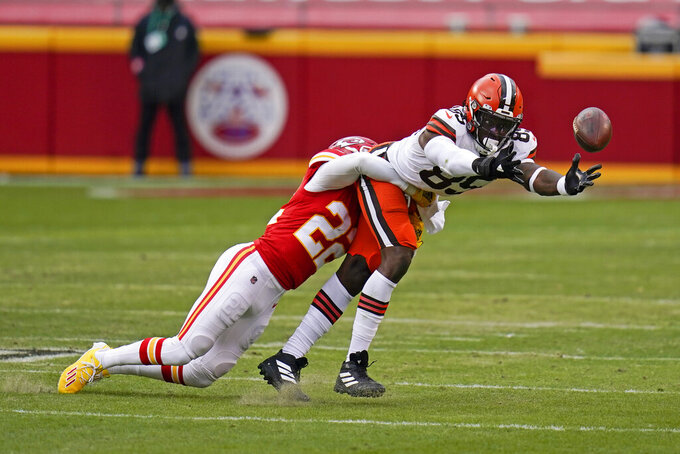 Kansas City Chiefs safety Juan Thornhill, left, breaks up pass intended for Cleveland Browns tight end David Njoku during the first half of an NFL divisional round football game, Sunday, Jan. 17, 2021, in Kansas City. (AP Photo/Jeff Roberson)