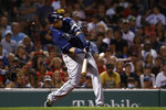 Tampa Bay Rays' Nelson Cruz hits a two-run home run against the Boston Red Sox during the third inning of a baseball game Tuesday, Sept. 7, 2021, at Fenway Park in Boston. (AP Photo/Winslow Townson)