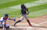 Atlanta Braves' Ronald Acuna Jr., right, hits a home run against the New York Mets during the sixth inning of a baseball game, Sunday, Sept. 20, 2020, in New York. (AP Photo/Noah K. Murray)