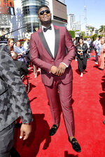 FILE - In this July 10, 2019, file photo, Zion Williamson arrives at the ESPY Awards in Los Angeles. The past few weeks have been a blur to Zion Williamson. Picked No. 1 in the NBA draft. Signed his first pro contract that could be worth as much as $45 million over the next four years. Went to summer league and got hurt after nine minutes. Landed a massive endorsement deal with Jordan Brand. And now, a video game deal. Williamson has signed with 2K, he and the video-game giant announced Tuesday, July 30, 2019, and the former Duke standout will make his video-game debut in NBA 2K20 when it launches on Sept. 6. (Photo by Richard Shotwell/Invision/AP, File)
