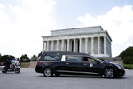 A hearse with the flag-draped casket of Rep. John Lewis, D-Ga., pauses in front of the Lincoln Memorial, Monday, July 27, 2020, in Washington, on way to the Capitol.  (AP Photo/Jose Luis Magana)
