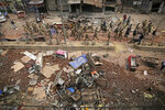 Indian paramilitary soldiers patrol a vandalized street in Tuesday's violence in New Delhi, India, Thursday, Feb. 27, 2020. India accused a U.S. government commission of politicizing communal violence in New Delhi that killed at least 30 people and injured more than 200 as President Donald Trump was visiting the country. The violent clashes between Hindu and Muslim mobs were the capital's worst communal riots in decades and saw shops, Muslim shrines and public vehicles go up in flames. (AP Photo/Altaf Qadri)