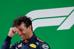 Red Bull driver Daniel Ricciardo of Australia reacts on the podium after winning the Chinese Formula One Grand Prix at the Shanghai International Circuit in Shanghai, Sunday, April 15, 2018. (AP Photo/Andy Wong)